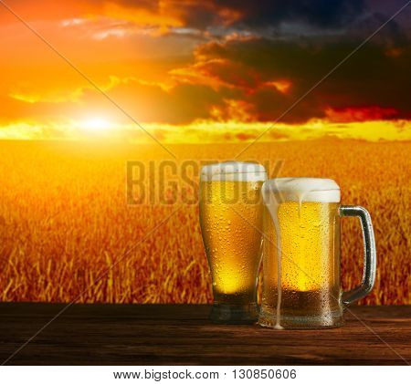 excellent light beer on a wooden table in a landscape