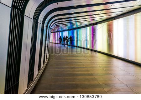 London United Kingdom - April 30 2016: 90 metre long curved foot tunnel with an LED integrated lightwall which links St Pancras International and King's Cross St Pancras Underground stations