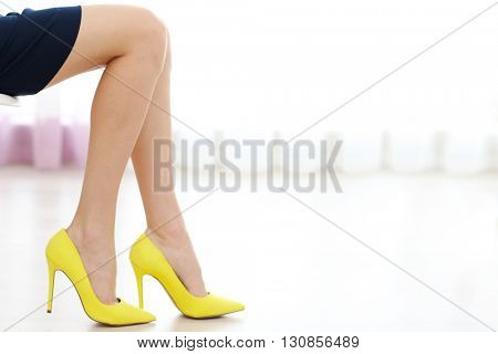 Woman wearing yellow high heels.