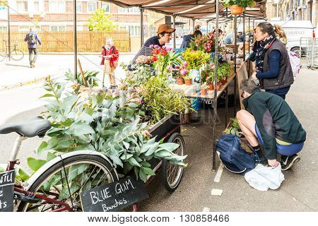 London United Kingdom - April 30 2016: Druid Street market in Bermondsey (located in railway arches). Great artisan street food stalls and bars. Florist stall