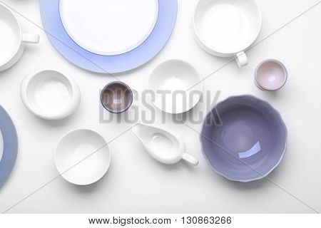 Empty white dishes on white background.