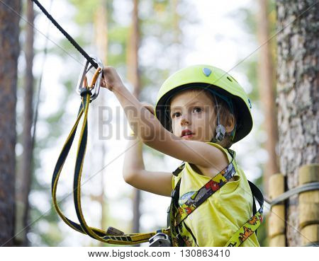 little cute boy in helmet runs track, leisure on nature extreme, lifestyle sport concept