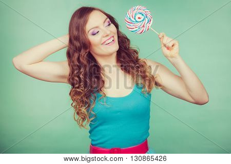 Smiling Girl With Lollipop Candy On Teal