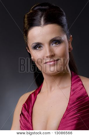 Closeup protrait of an attractive young women in evening dress and makeup.