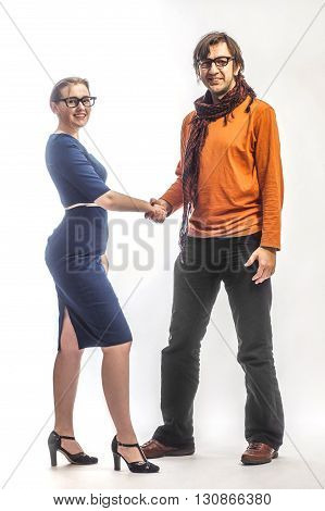 Full length of two people in glasses shaking hands on white background