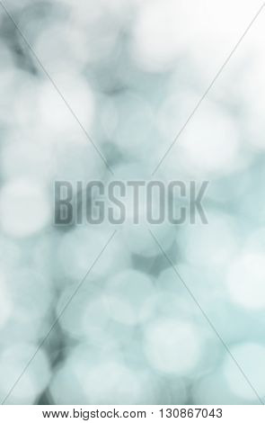 Abstract blurred white and blue background with blurred shapes in the form of an octahedron