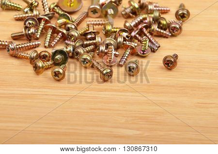 Some screw on a natural wooden background