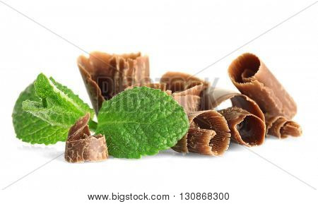Chocolate shavings with mint on white background