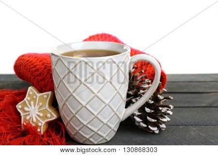 Beautiful winter composition with cup of hot drink, on wooden table with white background