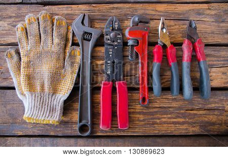 Construction tools on a wooden background or old wooden texture