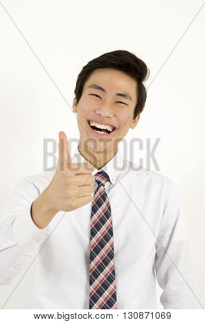 Successful asian businessman thumb up isolated on white background