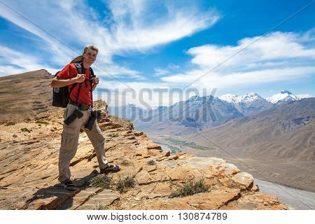 Nature photographer in Himalayas mountains. Spiti valley, Himachal Pradesh, India