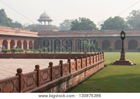 View of the famous Darwaza-i-rauza or the Great Gate inside Taj Mahal at Agra, Delhi. It is the entrance to the tomb in Taj Mahal. The lush green garden is seen too.