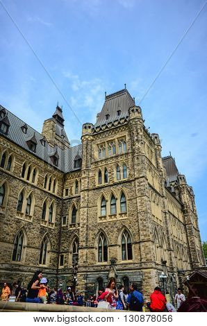 Ottawa Canada - May 21 2016: Parliament Hill in Canadian capital Ottawa a day before Queen Victoria day.People in line waiting to enter inside for tourist visite.