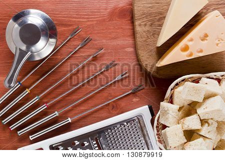 Special set of dishes and products for cooking cheese fondue