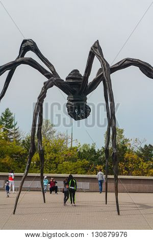 Ottawa Canada - May 21 2016:People taking photos under the biggest spider in the world
