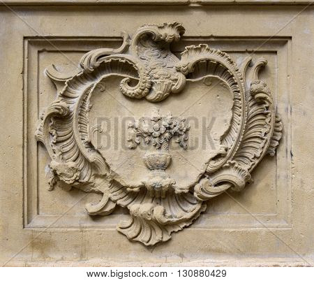 Straight on close up of elegant old classical style stone relief with decoration in rectangle