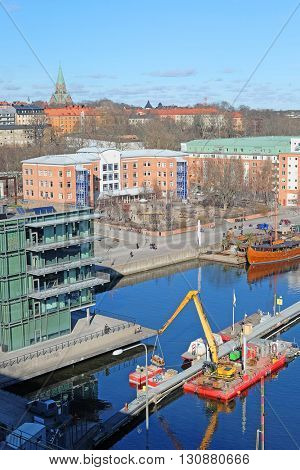 Stockholm, Sweden - March, 16, 2016: Tractor works at a construction in Stockholm, Sweden