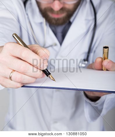 close-up hands and pen, the doctor signs a handle documents. Doctor writes medical history. write a prescription patient data history.