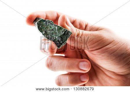 Holding A Fuchsite Piece