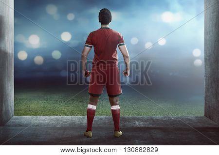 Back View Of Asian Football Player Standing