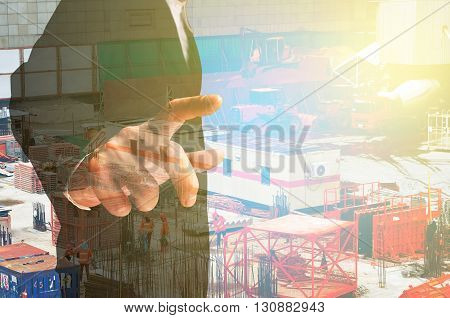 Double Exposure Of Businessman And Construction Site