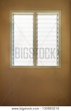 Glass window Louver or Shutter on Grunge Cement Wall as Background