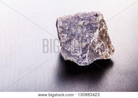 Lepidolite Stone On Wood