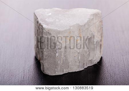 Selenite Stone On Wood Macro