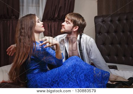 Married couple. Romantic evening at the hotel. Love and passion. Hotel at night