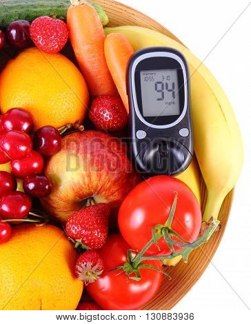 Glucometer with fresh ripe fruits and vegetables lying on wooden plate concept of diabetes healthy food nutrition and strengthening immunity