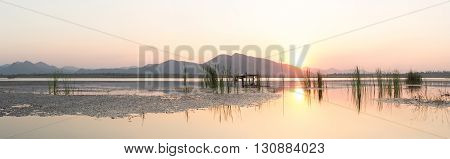 Twilight on the lake and mountain background Thailand