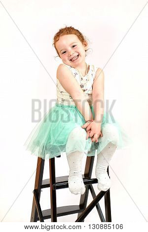 Fashion little girl in green dress in catwalk model pose stock photo. Image 09