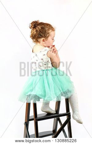 Fashion little girl in green dress in catwalk model pose stock photo. Image 12