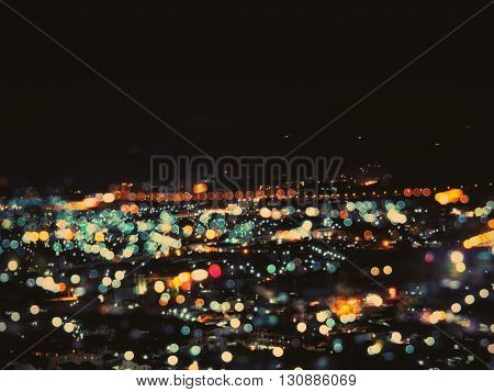 Abstract defocused night light cityscape from viewpoint Phuket Thailand. Vintage filter effect