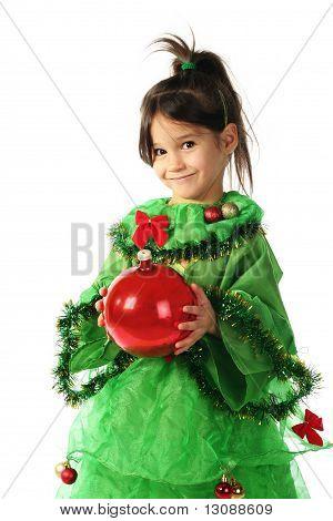 Little smiling girl in green Christmas tree costume
