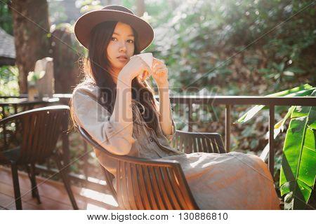 Woman Drinking Coffee In The Garden Outdoor In Sunlight Light Enjoying Her Morning Coffee
