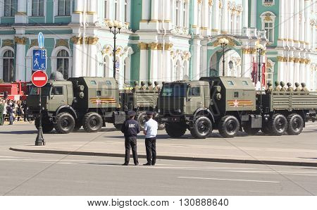 St. Petersburg, Russia - 9 May, Multifunction military trucks at the Winter Palace, 9 May, 2016. Festive military parade on the Palace Square in St. Petersburg.