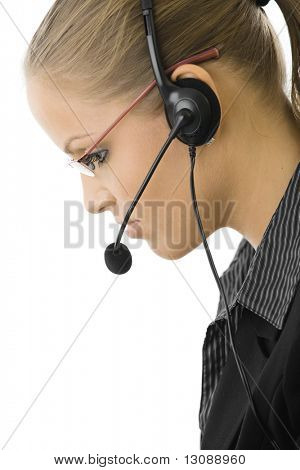 Young customer service operator girl wearing headset, side view, isolated on white background.