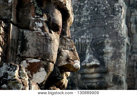 Two faces from Bayon the Heart of the Capital Angkor Thom