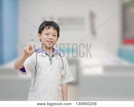 Young asian boy pretend to be doctor in hospital