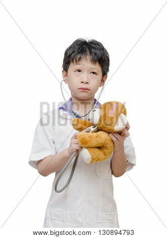 Young asian boy pretend to be doctor over white