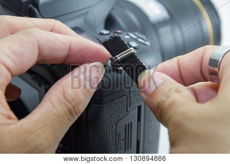 tied the camera strap by hand of human