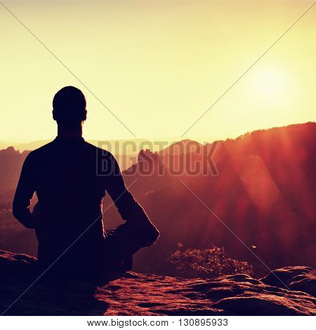 Hiker In Squatting Position On A Rock, Enjoy Dybreak  Scenery