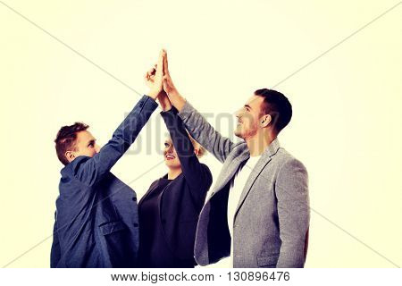 Business people giving high five