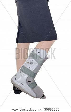Woman leg with an ankle brace isolated over white