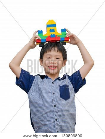 Young Asian boy with block airplane over white
