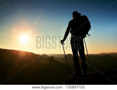 Tourist On Peak. Sunrise With Inversion.cliff Above Deep Autumn Valley With Tourist Guide On Top. Hi