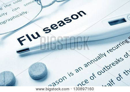 Flu season sign on a paper and glasses.