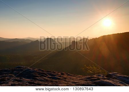 Sunny Flares In Lense. Colorful Daybreak. Misty Awakening In A Beautiful Hills. Peaks Of Hills Are S